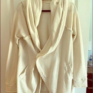 Cozy hooded free people sweater. Has pockets